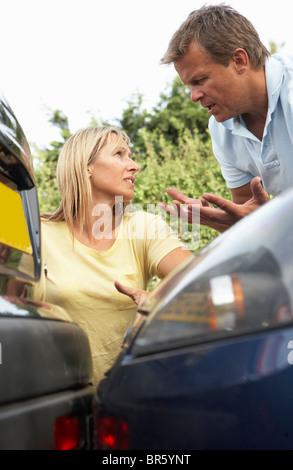 Man And Woman Having Argument After Traffic Accident - Stock Photo