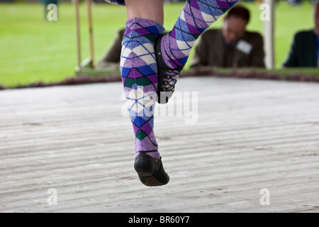 Female Highland reel Dancers, wearing purple socks at the Braemar Royal Highland Gathering and Games  Memorial Park, - Stock Photo
