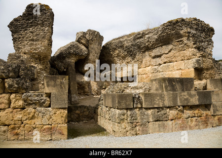 Roman building in grounds / surroundings of the amphitheatre at the ruined Roman city of Italica / Itálica near - Stock Photo