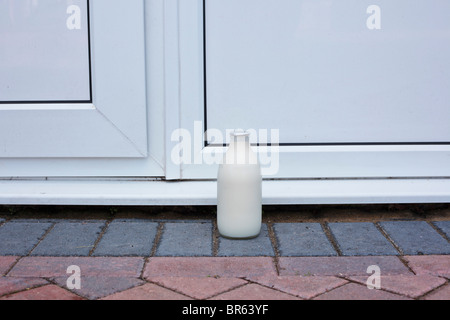 Pint of milk on the doorstep, UK - Stock Photo