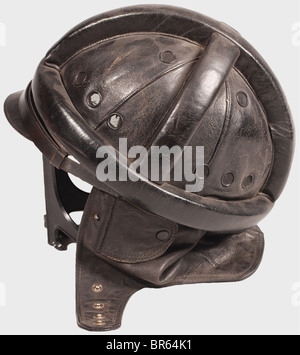 A Luftwaffe motorcycle suit., A black leather crash helmet with protective cylindrical padding, a one-piece neck - Stock Photo
