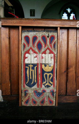 Painted Pew Ends, St Breward Church, Cornwall, depicting the Christograms of Jesus Christ and the Blessed Virgin - Stock Photo