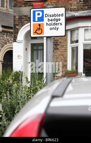 Disabled badge holders only sigh in residential area - Stock Photo