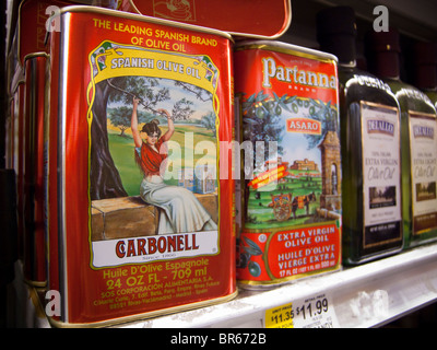 Cans of imported olive oil including Spanish are seen on a supermarket shelf - Stock Photo