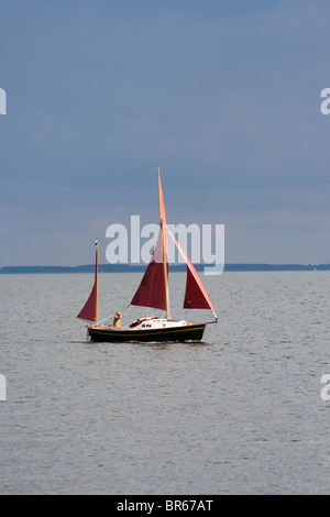 Small sail boat on the IJsselmeer, The Netherlands - Stock Photo
