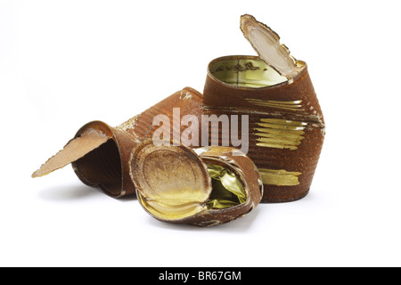 Crumpled old rusty tin cans on white background - Stock Photo