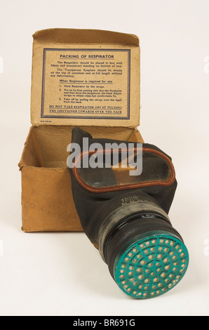 World War 2 Gas Mask in Original Cardboard Box with Instructions - Stock Photo