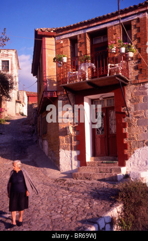 In Molyvos the cobblestone lanes of tiered stone houses are all protected by law; any new developement must conform - Stock Photo
