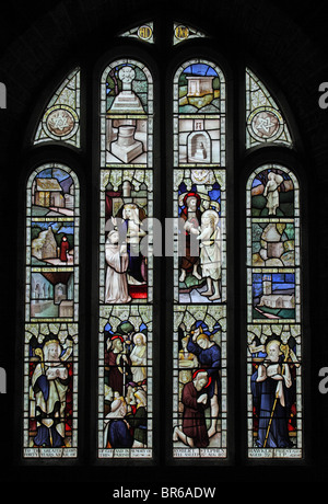 A stained glass window depicting scenes associated with Morwenstow Church and stories from the Bible - Stock Photo