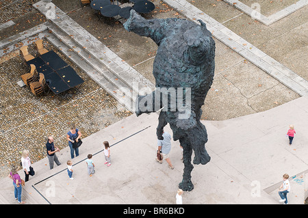 The palace of the popes in Avignon with an elephant sculpture 'Gran elefant dret' by Miquel Barcelò in the place - Stock Photo