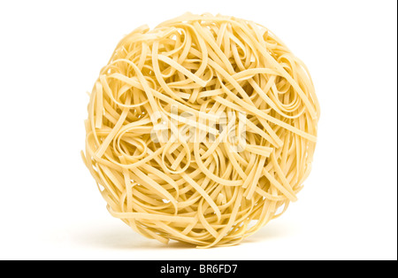 Nests of dried noodles from low perspective isolated on white. - Stock Photo