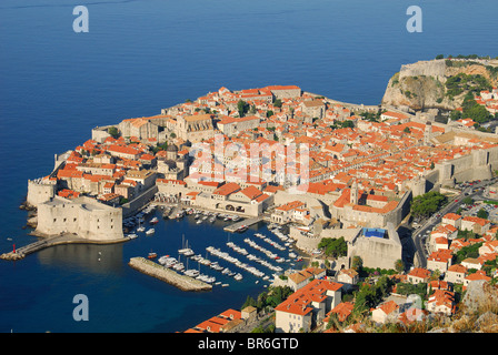 DUBROVNIK, CROATIA. An elevated early-morning view of the medieval town, harbour, walls and fortifications. 2010. - Stock Photo