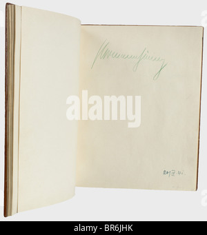 A guest book of the Panhans hotel on the Semmering., Brown leather cover with gold impression and gilt edging, on - Stock Photo