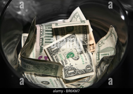 US bank notes in a container - Stock Photo