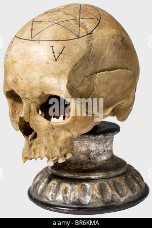 A ceremonial plumb bob and skull of a freemason lodge, German, 19th century. Elaborately crafted, knobbed brass - Stock Photo