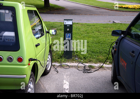 Electric car being charged in Oslo street - Stock Photo