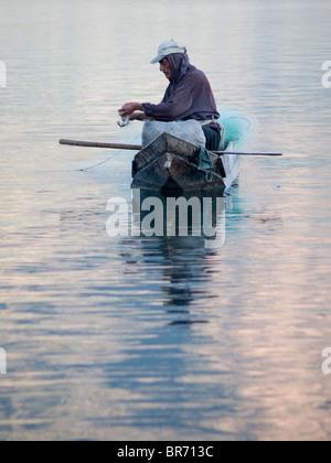 Fresh water fishermen at work on Lake Atitlan in Santiago Atitlan Guatemala. - Stock Photo