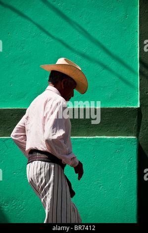Indigenous Man, traditional dressed, running down the streets of Santiago Atitlan village, Atitlan lake region, - Stock Photo