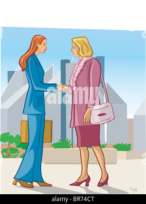 Two businesswomen shaking hands on a street - Stock Photo