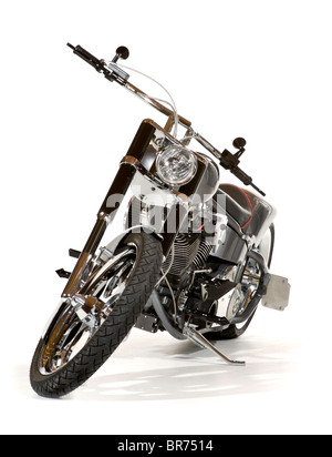 High end custom chopper motorcycle, seen from the front with handlebar and wheel turned toward the viewer. Isolated. - Stock Photo
