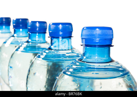 A row of bottles of water isolated on white - Stock Photo