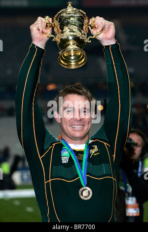 South African captain John Smit lifts the trophy after the 2007 IRB Rugby World Cup Final - Stock Photo