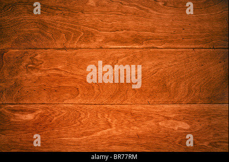 A beautiful deep, rich hardwood floor with its wood grain details for use as and background or appropriate housing - Stock Photo