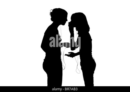 two gitl friends on white background with ipod - Stock Photo