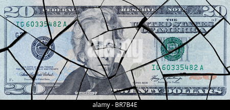 Cracked American twenty dollar bill concept to represent an economic crisis - Stock Photo