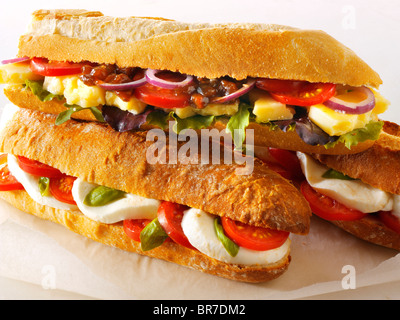 Bread baguettes filled with mozerella & tomatoes, and cheddar ploughmans with chutney - Stock Photo