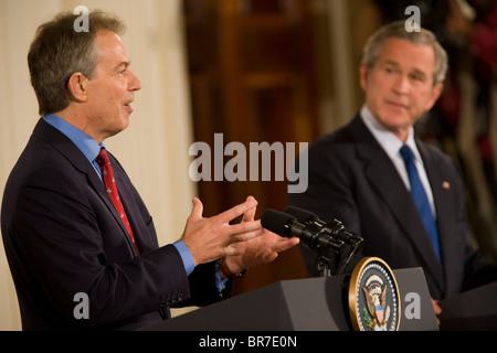 President Bush speaks to reporters along side Britain's Tony Blair - Stock Photo