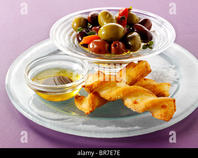 bowl of mixed olives with bread sticks - Stock Photo