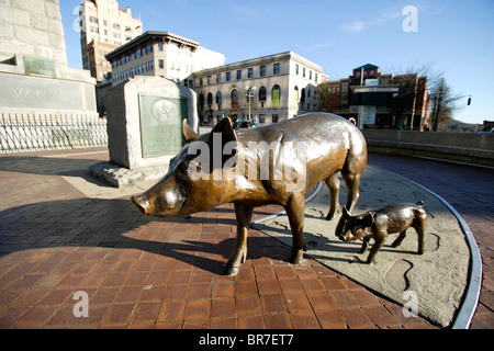 Public art - bronze pigs - at the Vance Memorial in Pack Sqaure in the heart of downtown Asheville NC - Stock Photo