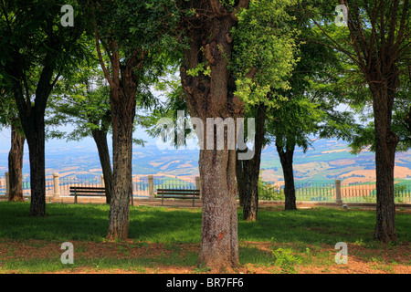 City park in Tuscan hill town Montalcino - Stock Photo