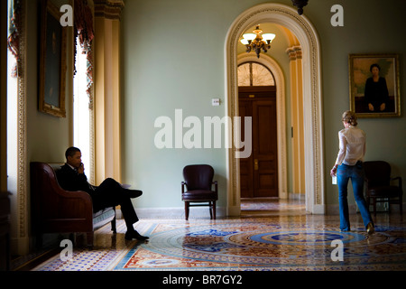 Barack Obama talks on a cell phone outside the Senate chambers of the U.S. Capitol - Stock Photo