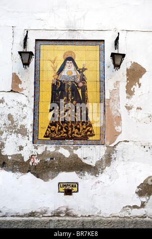 Religious icon [art] on a wall in the Plaza De San Leandro in the district of Santa Cruz Seville Spain. - Stock Photo