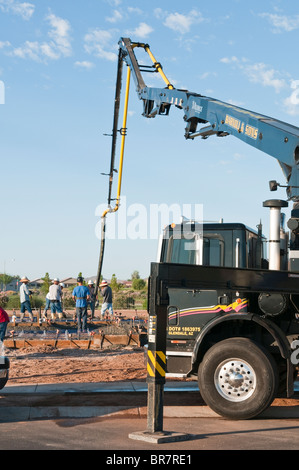 Concrete is being pumped for the foundation and floor of a new home under construction in Arizona. - Stock Photo
