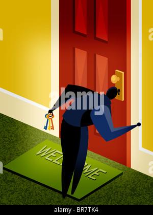 A man looking through a key hole - Stock Photo