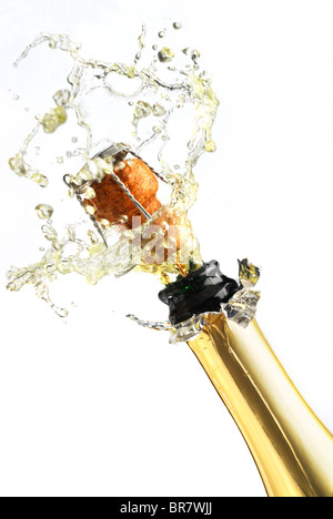 Extreme close-up image of explosion of champagne bottle cork - Stock Photo