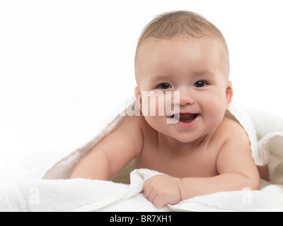 Portrait of a smiling four month old baby boy looking at the camera. Isolated on white background. - Stock Photo