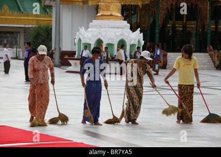 Shwedagon TempleRanggon Myanmar Burma Women Cleaning - Stock Photo