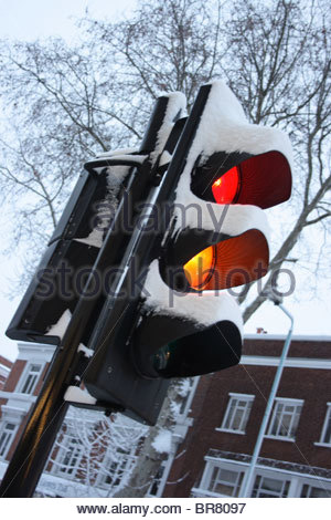 Snow covered traffic lights in Chiswick - Stock Photo