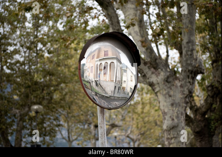 View of Lakeside home in parking mirror, Iseo, Lake Iseo, Lombardy, Italy - Stock Photo