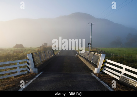 A misty road bridge in Tolaga Bay on the East Cape, New Zealand. - Stock Photo