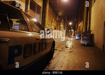 Vancouver police department cop car in alley at night, Vancouver, British Columbia, Canada - Stock Photo