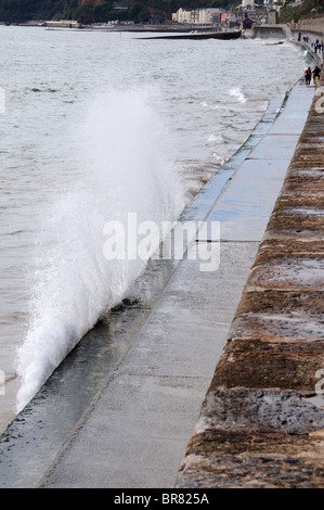 Waves splashing on the sea wall at Dawlish in Devon - Stock Photo