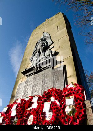 War Memorial with Poppy Wreaths - Stock Photo