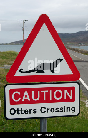 'Otters Crossing' road sign at causeway from Eriskay to South Uist in the Outer Hebrides, Scotland - Stock Photo