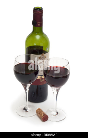 Two glasses of red wine with bottle of Torres Coronas Tempranillo - Stock Photo