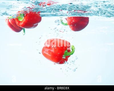 Red paprika underwater - Stock Photo